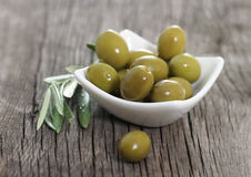 Green olives in the bowl Stock Images