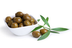Green olives in bowl isolated on white. Stock Images