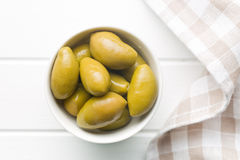 Green olives in bowl Stock Photo