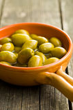Green olives in bowl Royalty Free Stock Images