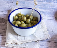 Green olives in bowl on napkin Royalty Free Stock Images