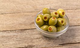 The green olives in bowl Stock Photo