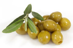 Green olives and branch. Green olives with olive branch on white background Royalty Free Stock Photos