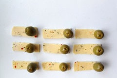 Green olives and cheese Stock Photography