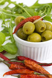 Green olives, chili, basil and rucola Stock Photography