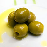 Green Olives covered in oil Stock Image