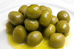 Green Olives covered in oil Royalty Free Stock Photo