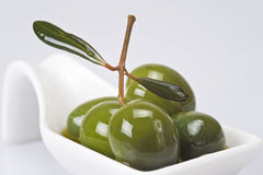 Green olives covered in oil royalty free stock photography
