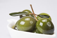 Green olives covered in oil royalty free stock photos