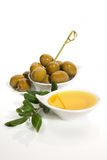 Green olives and extra virgin olive oil Royalty Free Stock Image