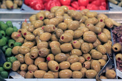 Green olives in food store Stock Photos