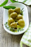 Green olives with fragrant oil Royalty Free Stock Photos
