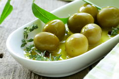 Green olives with fragrant oil Stock Photography
