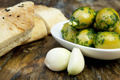 Green olives with fresh bread and herbs Stock Image