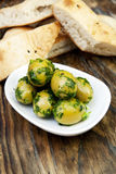 Green olives with fresh bread and herbs Royalty Free Stock Photo