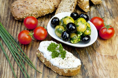 Green olives with fresh bread and herbs Royalty Free Stock Photography