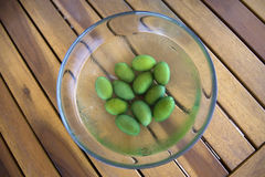 Green olives. Green fresh olives on a wooden table Stock Images