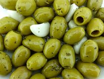 Green olives with garlic Stock Images