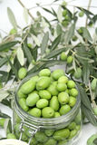 Green olives in a glass jar Stock Photo