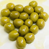 Green Olives in heart shape Royalty Free Stock Photography