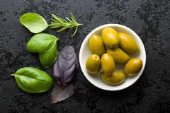 Green olives and herbs Stock Photo