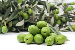 Green olives isloated on white. Pile of green healthy olives isloated on white Royalty Free Stock Image