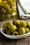 Green olives on kitchen table Royalty Free Stock Image