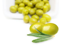 Green olives with leaves Royalty Free Stock Photos