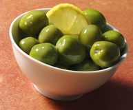 Green Olives and lemon Stock Images
