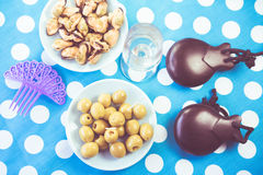 Green olives, mussels and costume jewelry stock image