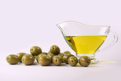 Green olives and oil. On white background Stock Image