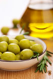 Green olives and oil Royalty Free Stock Photos