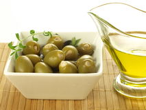 Green olives and oil Stock Images