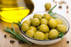 Green olives and oil Royalty Free Stock Image