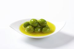 Green olives in oil Stock Photography