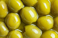 Green olives in olive oil Royalty Free Stock Photography