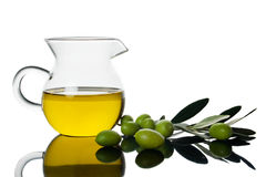 Green olives and olive oil Royalty Free Stock Photography
