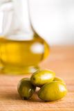 Green olives and olive oil Royalty Free Stock Image