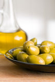 Green olives and olive oil Stock Photo