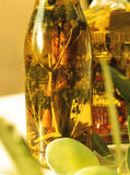 Green olives and olive oil with spice and herbal Royalty Free Stock Image