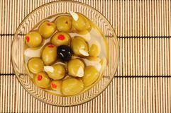 Green olives with one black Royalty Free Stock Image