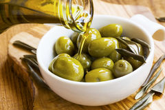 Green olives with organic olive oil Royalty Free Stock Images