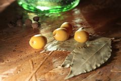 Green olives with other spices Royalty Free Stock Image