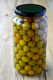 Green Olives pickled In glass container Stock Photos