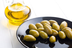 Green olives on plate Stock Photos