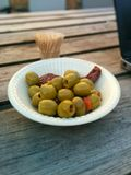 Green olives. Plate with olives and some dry tomatoes Royalty Free Stock Photography