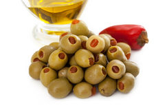 Green olives with red pepper Royalty Free Stock Photography