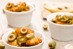 Green olives and roasted chicken Stock Photography