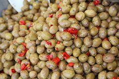 Green OLIVES for sale at the market specialized in Mediterranean. Many ripe green OLIVES for sale at the market specialized in Mediterranean products Stock Image