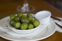 Green Olives. Shiny Green Olives in a White Bowl Royalty Free Stock Images